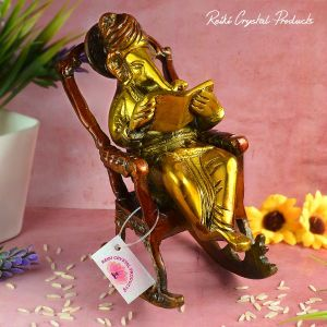Brass Lord Ganesha Statue Sitting on a Chair